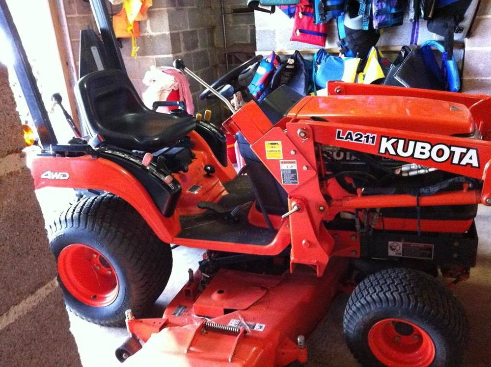 orange 2003 kubota bx2200 lawn mower with a mowing deck that was stolen