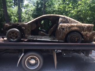 car retrieved from Weiss Lake sitting on a flat bed trailer