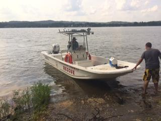 Members of the Cherokee County Rescue Squad preparing to retrieve vehicles from Weiss lake