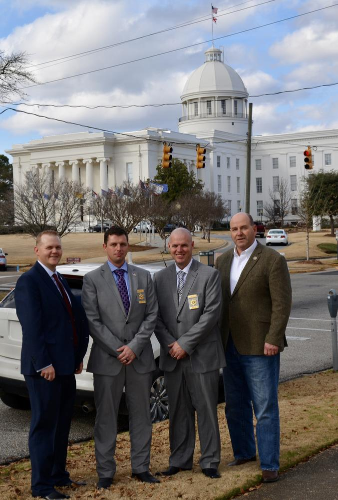 Chief Investigator Josh Summerford and Investigator Jeremy Stepps with other members of the ALEA standing in front of the capital building