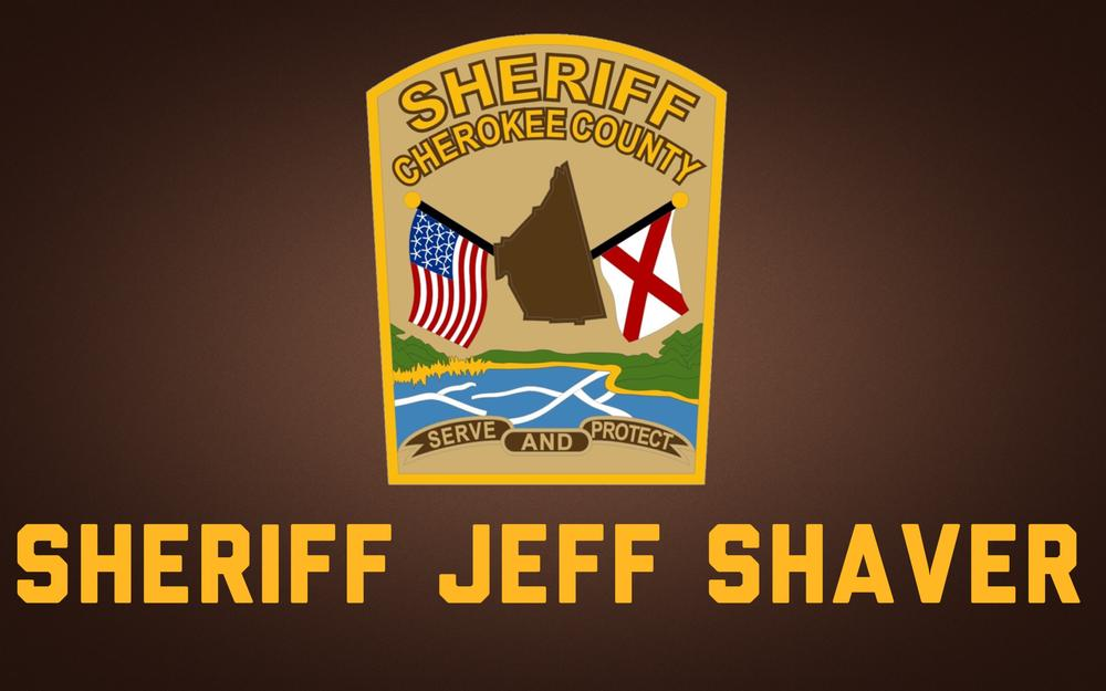 brown background with Cherokee County Sheriff patch and Sheriff Jeff Shaver text in gold