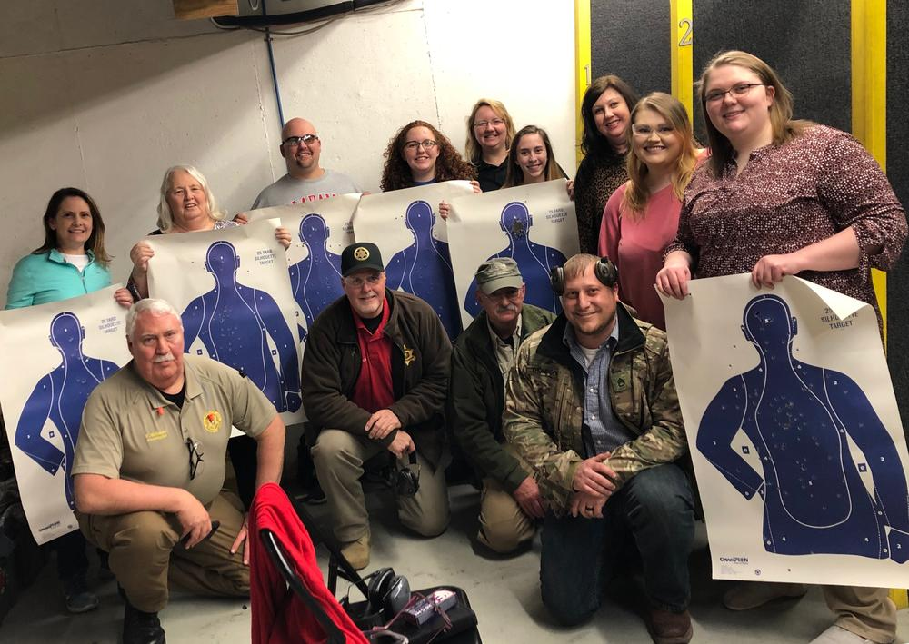 students from the citizen's firearms safety class with their paper targets