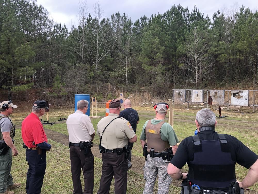 six deputies wait for their turn to take target practice