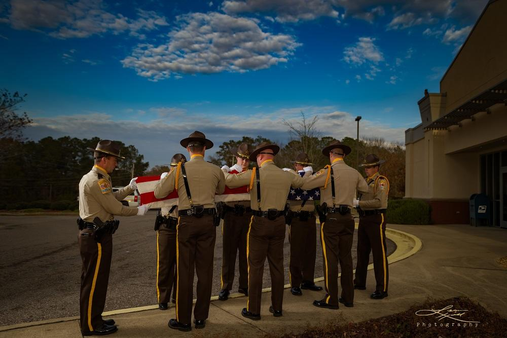 Cherokee County Sheriff's Office Honor Guard in the process of folding the American flag