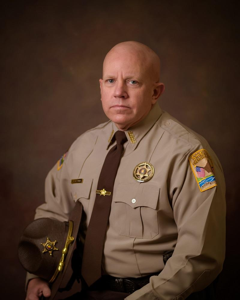 Professional portrait of Deputy Michael Farrell